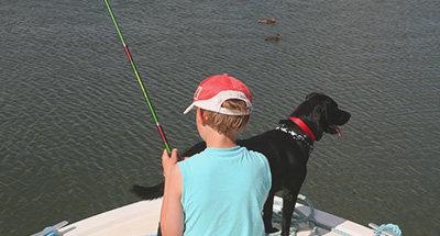 Pescare con il suo cane